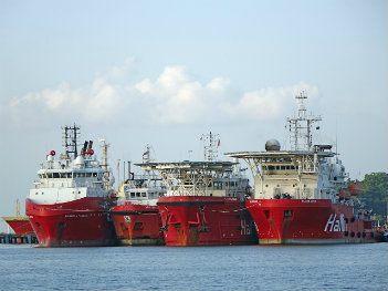 Three shipping vessels